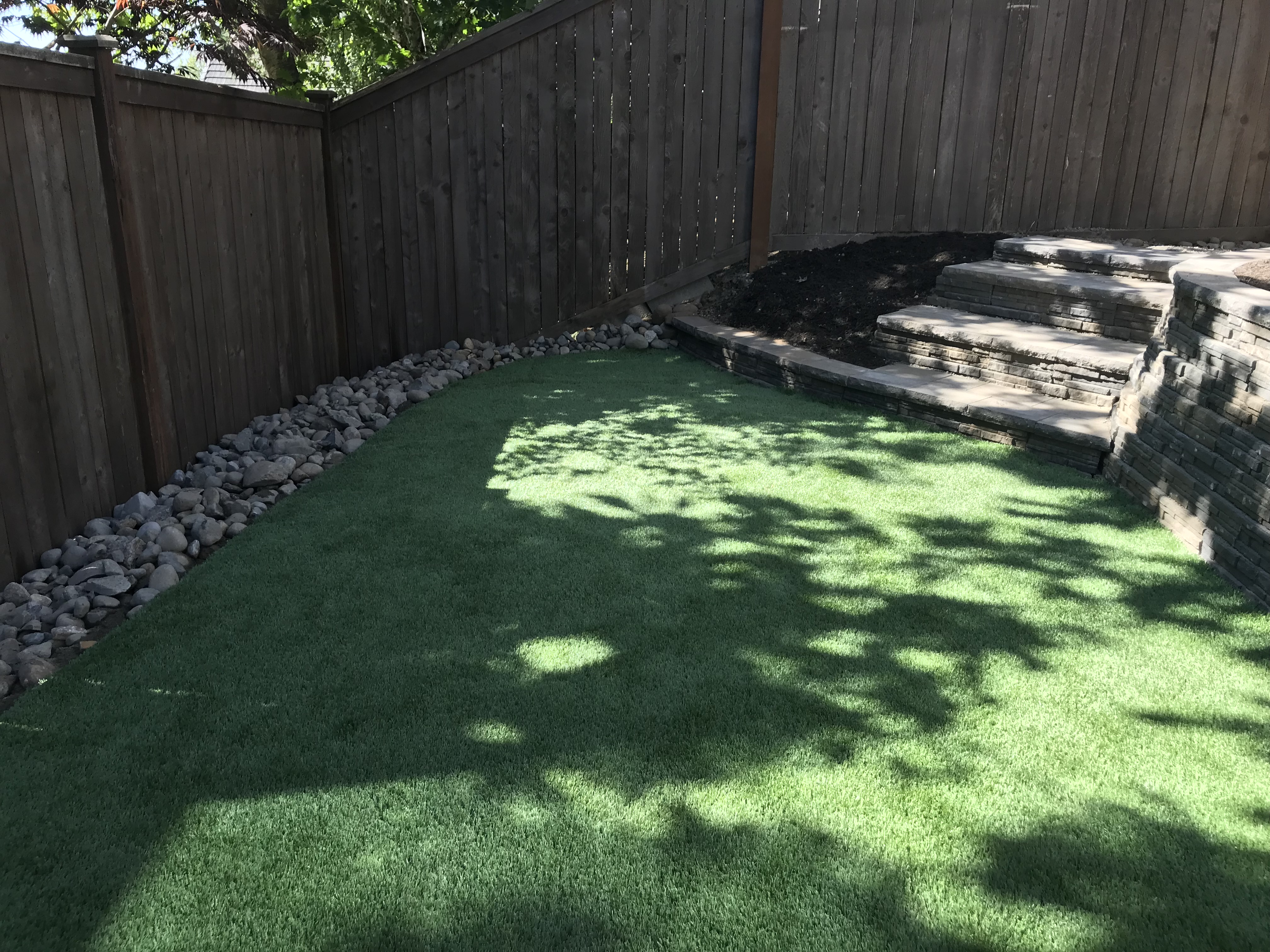 new synthetic turf and retaining wall