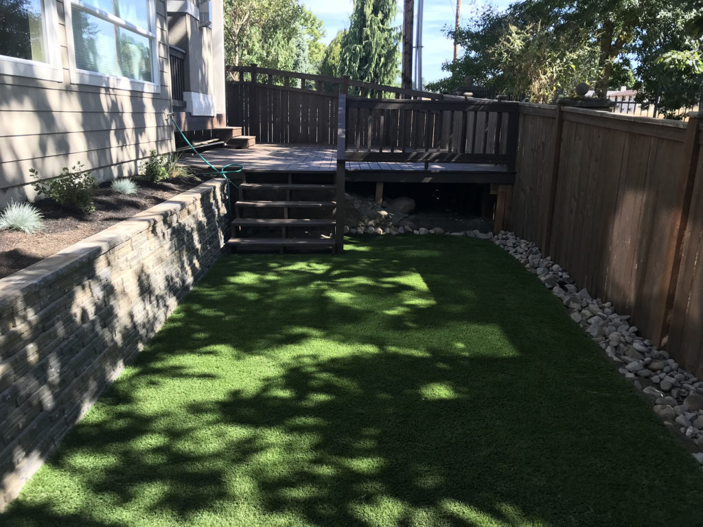 new synthetic turf, retaining wall and deck