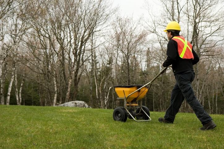 Fertilizer application by a man
