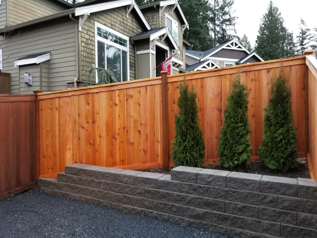 New fence and retaining wall