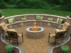 A photo of a recessed seating area with a fire pit.