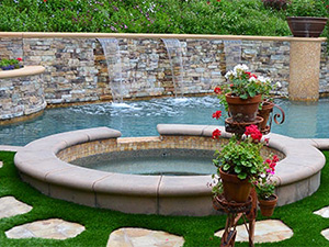 A photo of a backyard water feature.