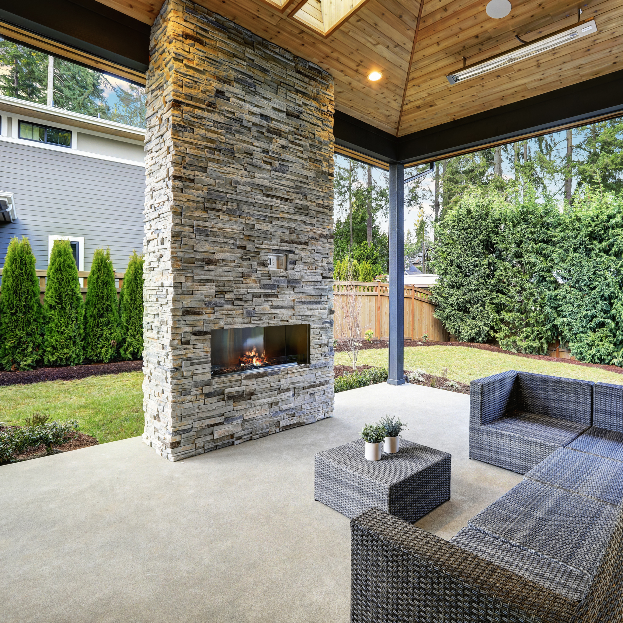 A photo of a backyard fireplace with seating.