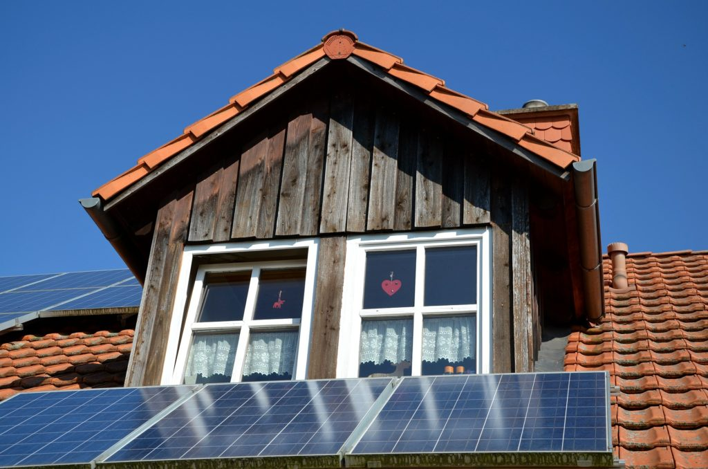 A photo of a house roof with solar panels.