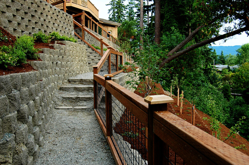 A photo of stairs leading up a series of retaining walls.